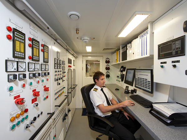 Superyacht chief engineer at his station